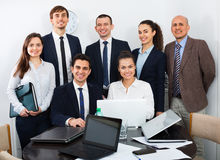 Portrait of positive smiling corporate managers royalty free stock photography