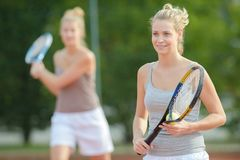 Portrait positive smiling professional female tennis player stock photo