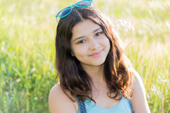 Portrait of positive teen girl outdoors in summer. Portrait of a teen girl outdoors in summer Royalty Free Stock Image