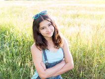 Portrait of positive teen girl outdoors in summer. Portrait of a teen girl outdoors in summer Stock Image