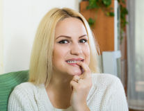 Portrait of positive woman with finger over lips Royalty Free Stock Image