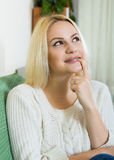 Portrait of positive woman with finger over lips Stock Photo