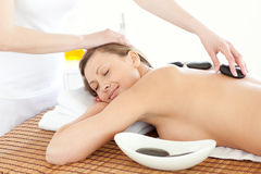Portrait of a positive woman having a massage Stock Images