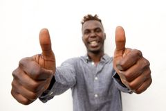 Positive young african man smiling with two thumbs up. Portrait of positive young african man smiling with two thumbs up Stock Photos