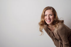 Portrait of positive young blonde woman with long hair Stock Photography