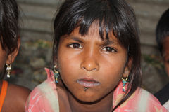 Portrait in Poverty. A portrait of a poor Indian beggar girl Royalty Free Stock Image