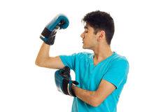 Portrait of powerful brunette sports man practicing box in blue gloves isolated on white background Royalty Free Stock Photo