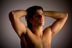 Portrait of powerful man showing muscles Stock Photo