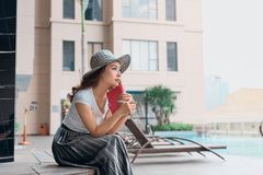 Portrait of pPretty cheerful woman relax and reading book in vac stock image