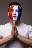 Portrait of Pray France football fan in game  of France national  team look at camera. Stock Photo