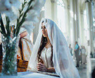 Portrait of the Praying bride. The bride prays on a background window royalty free stock photography