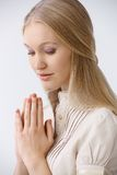 Portrait of praying woman Stock Image