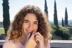 Portrait of a pre-adolescent girl. Posing in a public park on a sunny spring day stock photos