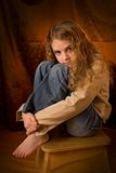Portrait pre teen. Pre teen girl sitting on stool with legs up Stock Images