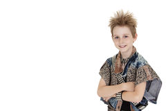 Portrait of pre-teen boy standing with arms crossed over white background Royalty Free Stock Images