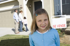 Portrait of pre-teen girl (7-9) in front of new house Royalty Free Stock Photos
