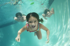 Portrait of a preadolescent children swimming underwater Stock Photo