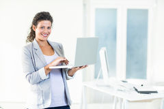 Portrait of pregnant businesswoman using laptop Royalty Free Stock Photos