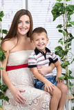 Portrait of a pregnant mom and son Royalty Free Stock Photography
