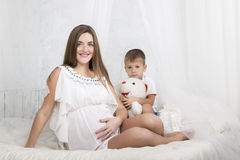 Portrait of pregnant mother and her son Stock Image