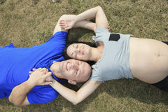 A portrait of a pregnant wife with her husband Royalty Free Stock Image