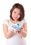 Portrait of pregnant woman with baby shoes Royalty Free Stock Image