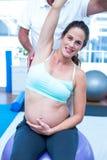 Portrait of pregnant woman exercising Stock Photos