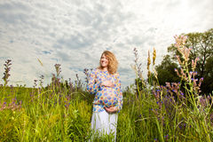 Pregnant woman on the  field Stock Photo