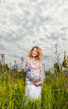 Pregnant woman on the  field Royalty Free Stock Photography