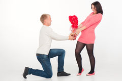 Portrait of a pregnant woman and her husband with flowers Stock Image