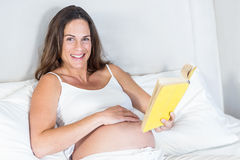 Portrait of pregnant woman with novel Royalty Free Stock Photo