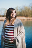 Portrait of pregnant woman in shore to the river Royalty Free Stock Photography