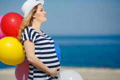 Portrait of pregnant woman with sunglasses and hat Royalty Free Stock Image