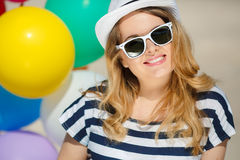 Portrait of pregnant woman with sunglasses and hat Stock Photos