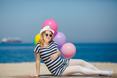 Portrait of pregnant woman with sunglasses and hat Stock Image