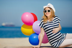 Portrait of pregnant woman with sunglasses and hat Stock Images