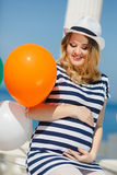 Portrait of pregnant woman with sunglasses and hat Royalty Free Stock Photography
