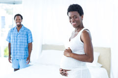 Portrait of pregnant woman touching her belly Royalty Free Stock Image