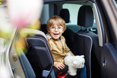 Portrait of preschool kid boy sitting in car Stock Image