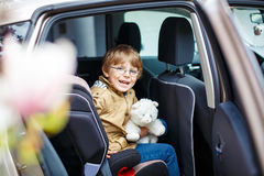 Portrait of preschool kid boy sitting in car Royalty Free Stock Photos