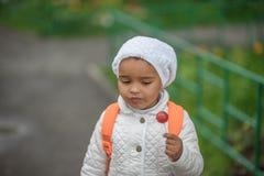 Portrait of preschooler girl. With lollypop Stock Image
