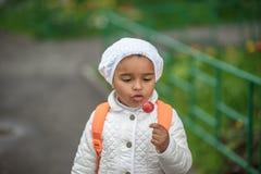 Portrait of preschooler girl. With lollypop Stock Photos