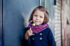 Portrait of preschooler girl with lollypop. Young toddler girl eating candy Stock Photography