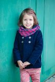 Portrait of preschooler girl near green wall. Young toddler girl outdoor. This image has attached release Stock Photos
