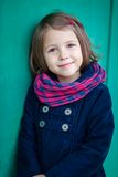 Portrait of preschooler girl near green wall. Young toddler girl outdoor. This image has attached release Royalty Free Stock Image