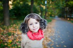 Portrait of preschooler girl outdoor in the park. Small girl outdoor in the park with yellow leaves Stock Images