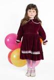 Portrait of preschooler girl in velvet dress Royalty Free Stock Image