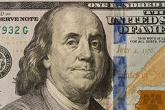 Portrait of President Benjamin Franklin on 100 dollar bill . Close up royalty free stock photos
