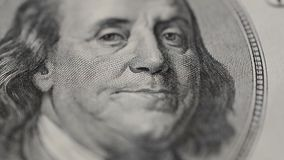 Portrait of President Benjamin Franklin on a Hundred Dollar bill Rotate in Macro. stock video