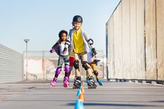 Happy inline skaters rolling at skate park Stock Image